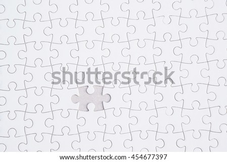 Close up of the last jigsaw puzzle piece, Missing jigsaw puzzle piece - stock photo
