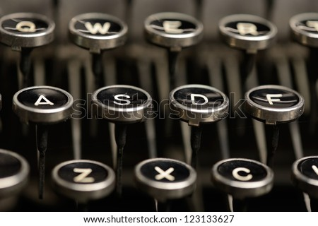 Close-up of the left half of home row keys on an old typewriter. Shallow DOF. - stock photo