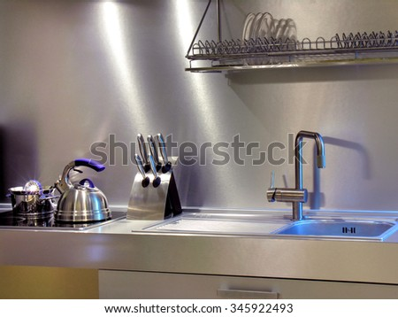 close-up of the modern kitchen equipment in the home interior in mixed lighting           - stock photo