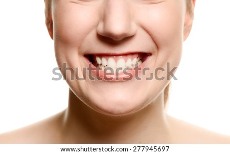 Close up of the mouth of a smiling woman showing her teeth in a dentistry, oral hygiene and healthcare concept, isolated on white - stock photo