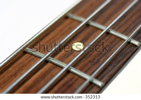 Close up of the neck of an electric bass guitar - stock photo