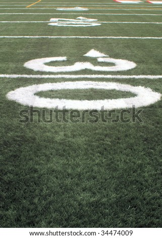 close-up of The number thirty on an american football field - stock photo