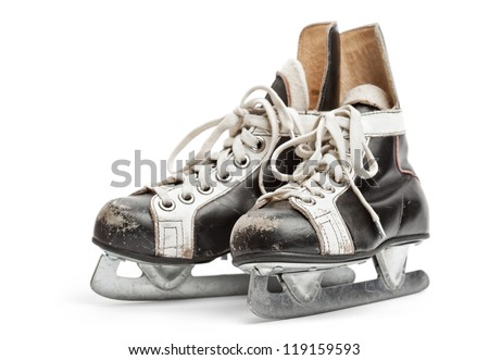 Close-up of  the old ice skates, isolated on white background with soft shadow. Focus on front. - stock photo