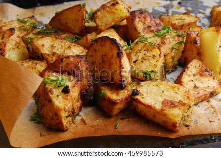 close up of the roasted potatos - stock photo