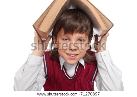Close up of the schoolboy with the book  isolated on a white - stock photo
