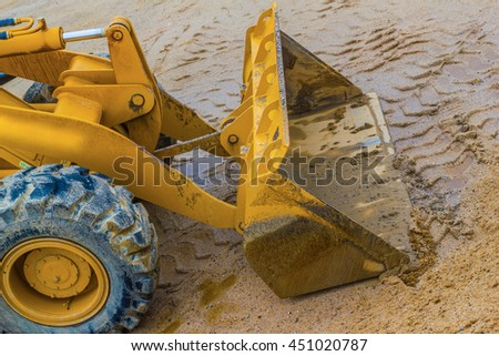 Close up of the scoop on an end loader at a construction site. - stock photo