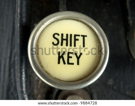 Close up of the shift key on an old typewriter. - stock photo