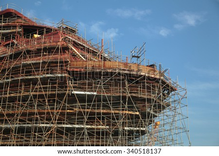 Close up of the ship under construction with scaffolding - stock photo