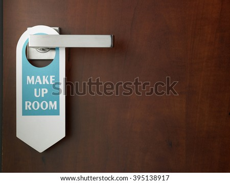 close up of the sign -make up room on door handle  - stock photo