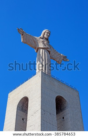 Close-up of the statue of Christ placed on top of the Cristo-Rei or King-Christ Sanctuary in Almada. The second most visited sanctuary in Portugal, and a popular landmark among tourists. - stock photo