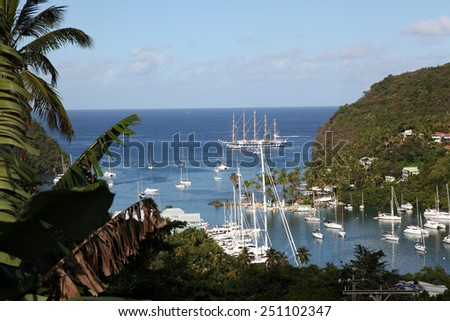 Close-up of the stern of a Yacht moored against the quay in Marigot bay, St. Lucia, Caribbean  - stock photo