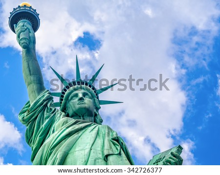 Close up of the The Statue of Liberty in New York with a beautiful sky - stock photo