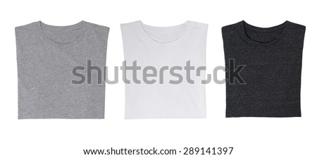 Close-up of the three t-shirts (black, white and grey). Isolated. - stock photo