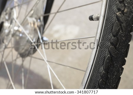 Close-up of the tire on a wheel of a bike with spokes - stock photo