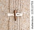 Close up of the toggle on a warm winter jumper - stock photo