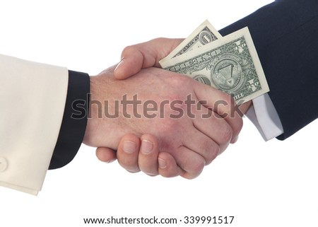close-up of the transfer of money from hand to hand on a white studio background - stock photo