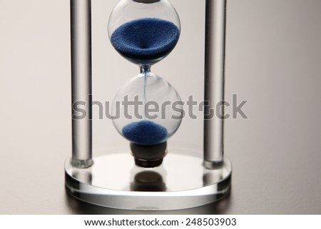 close up of the transparent hour glass - stock photo
