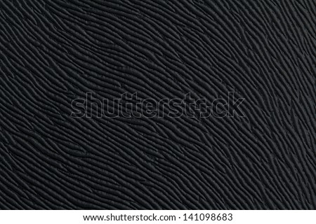 close up of the weave of black material - stock photo