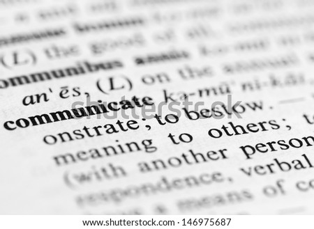 Close up of the word 'communicate' and its definition in the dictionary - stock photo