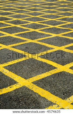 Close up of the yellow lines of a British road box junction. - stock photo
