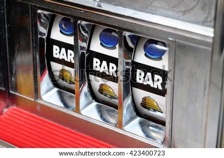 Close up of three bar jackpot on a casino slot machine - stock photo
