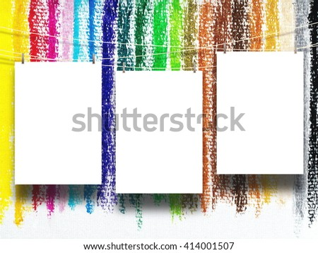 Close-up of three blank frames hanged by pegs against multicoloured chalk background - stock photo