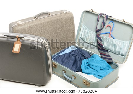 Close-up of three old suitcases isolated on white - stock photo