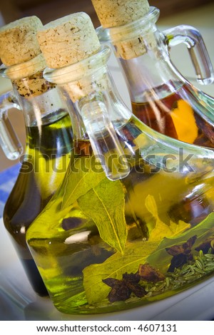Close up of three olive oil and balsamic vinegar bottles - stock photo
