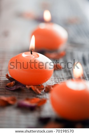 Close up of three orange candles with shallow focus - stock photo