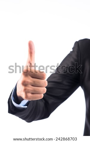 Close-up of thumbs up sign - hand gesture isolated on white background. Successful business man concept. - stock photo