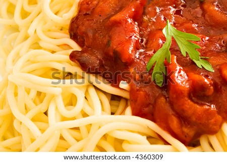 Close-up of tomato sauce and parsley on spaghetti - stock photo