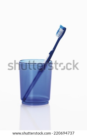 Close up of toothbrush in toothbrush holder - stock photo