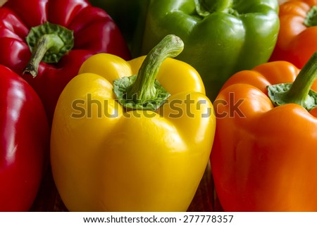 Close up of tops of assorted colorful bell peppers - stock photo
