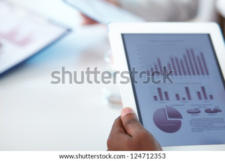 Close-up of touchpad in businessman hands - stock photo
