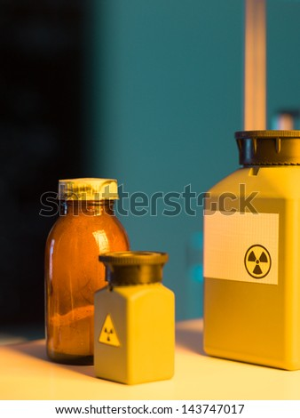 close-up of toxic waste containers placed on a shelf in a laboratory - stock photo