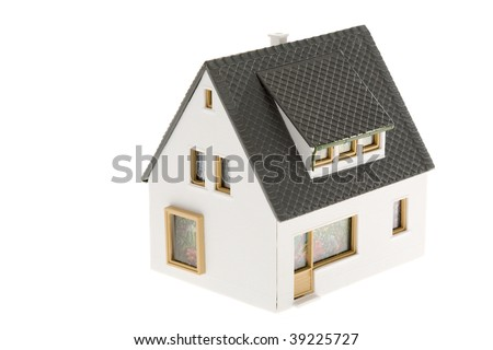 Close-up of toy house model on white background - stock photo