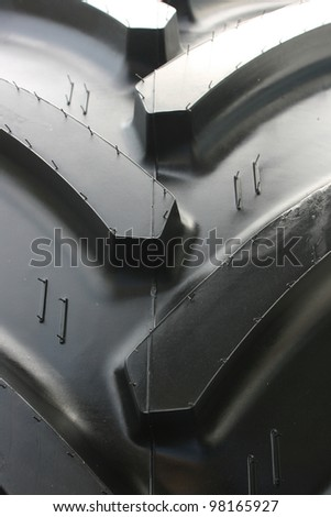 Close-up of tractor tire with rubber needles (very shallow DOF) - stock photo