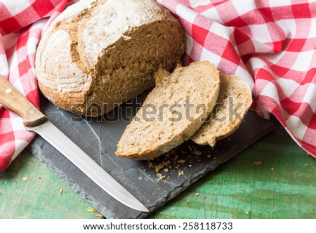 Close-up of traditional homemade bread on napkin - stock photo