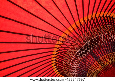Close up of traditional Japanese red umbrella  - stock photo