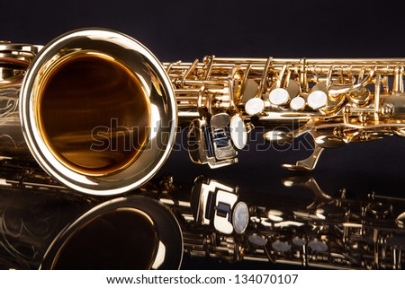 Close-up Of Trumpet Over Black Reflective Background - stock photo