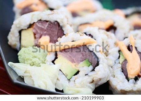 Close up of tuna sushi with extreme shallow depth of field. - stock photo