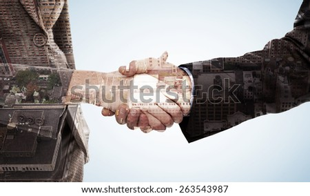 Close up of two businesspeople shaking their hands against new york - stock photo