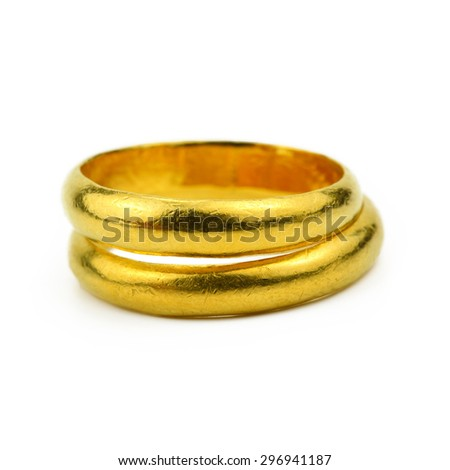 close up of Two gold rings on white background, ring for wedding as commitment concept. - stock photo