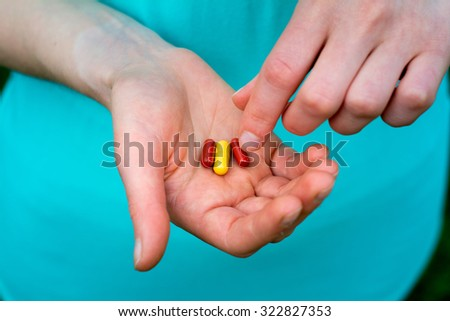 Close-up of two human hands, the hands are capsules  - stock photo