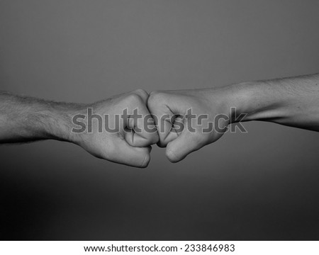 Close up of Two men punching - stock photo
