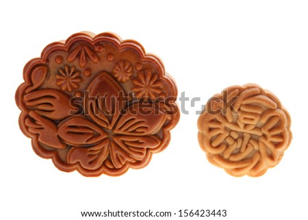 Close up of two mooncakes isolated on white background. (The chinese words indicates the type of mooncake, not the brand) - stock photo