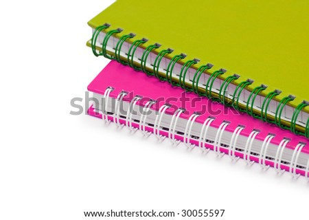Close up of two notebooks isolated on white - stock photo