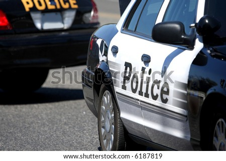 Close up of two police cars parked - stock photo