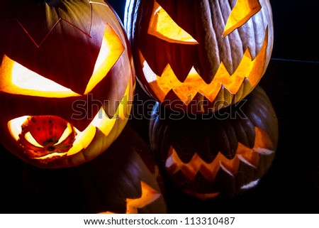 Close-up of two pumpkins for Halloween - stock photo