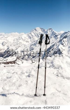 close up of two ski poles sticks - stock photo